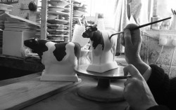 Jane Davies at Rye Pottery today, hand-painting a Black and White Cow, another of the figures in our popular Animals Collection